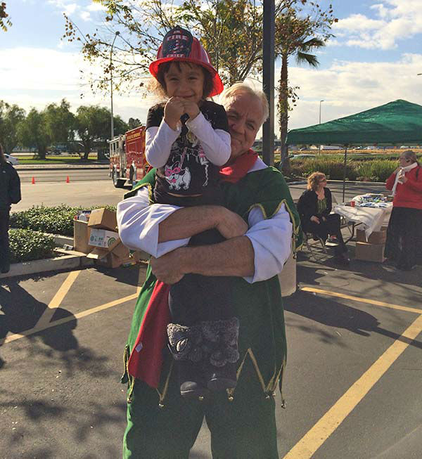 "<div class=""meta ""><span class=""caption-text "">Garth the Elf poses with 4-year-old Marie from Claremont at our Stuff-A-Bus event at Mathis Brothers in Ontario on Friday, Dec. 6, 2013. (KABC Photo)</span></div>"