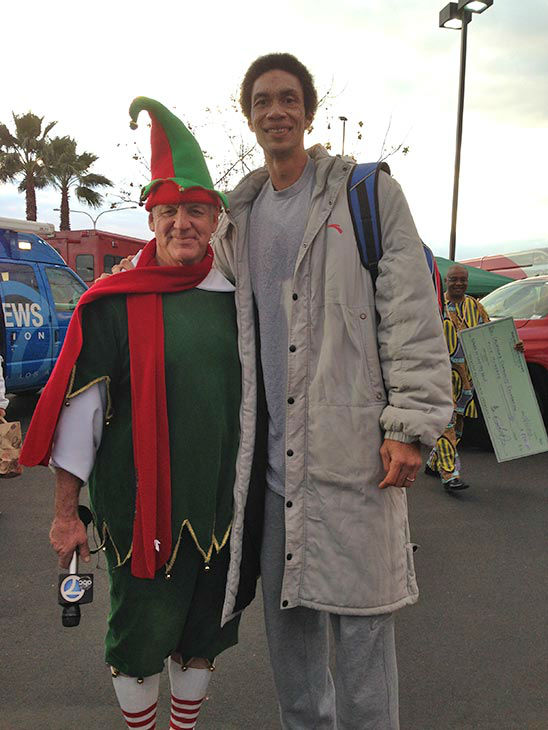 Garth the Elf with retired LA Clippers player Keith Cross at our Stuff-A-Bus event at Mathis Brothers in Ontario on Friday, Dec. 6, 2013. <span class=meta>(KABC Photo)</span>