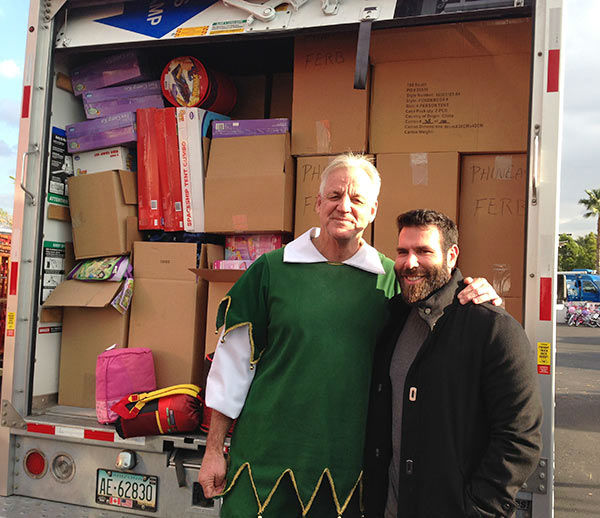 Garth the Elf poses with Dan from West Hollywood at our Stuff-A-Bus event at Mathis Brothers in Ontario on Friday, Dec. 6, 2013. <span class=meta>(KABC Photo)</span>