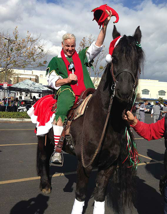Garth the Elf poses with Dignity the Horse at our Stuff-A-Bus event at Mathis Brothers in Ontario on Friday, Dec. 6, 2013. <span class=meta>(KABC Photo)</span>
