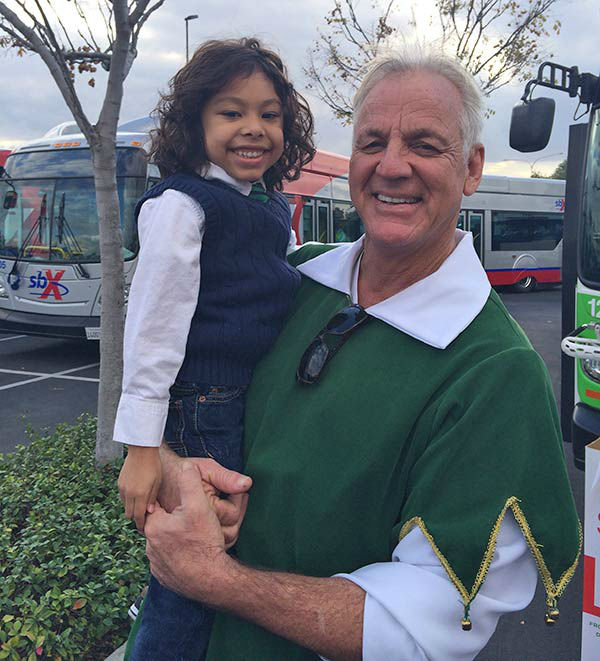 Garth the Elf poses with 5-year-old Jaire from Corona at our Stuff-A-Bus event at Mathis Brothers in Ontario on Friday, Dec. 6, 2013. <span class=meta>(KABC Photo)</span>