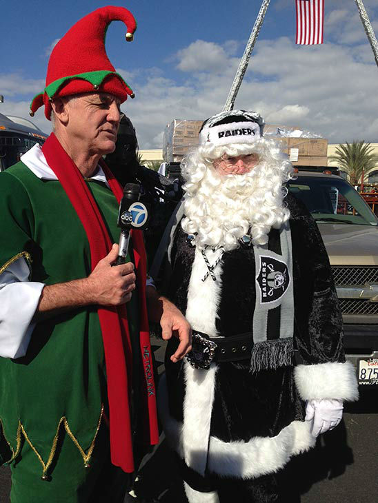 Garth the Elf hangs out with Raider Santa at our Stuff-A-Bus event at Mathis Brothers in Ontario on Friday, Dec. 6, 2013. <span class=meta>(KABC Photo)</span>