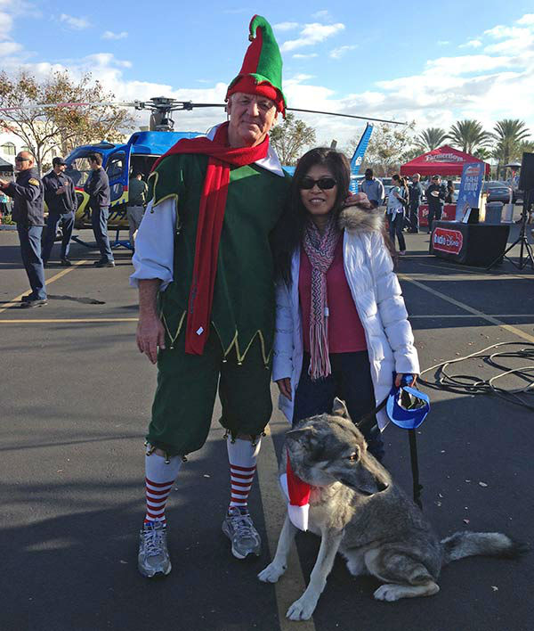 Garth the Elf poses with a viewer at our Stuff-a-Bus event at the Mathis Brothers in Ontario on Friday, Dec. 6, 2013. <span class=meta>(KABC Photo)</span>