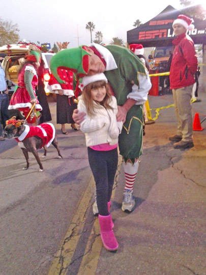 Morgan Forseund of Woodland Hills poses with Garth the elf after donating toys to the Stuff-a-Bus event in Canoga Park on Friday, Dec. 13, 2013. <span class=meta>(KABC Photo)</span>