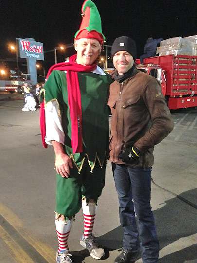 Actor Gunnar Wright poses with Garth the elf after donating toys to the Stuff-a-Bus event in Canoga Park on Friday, Dec. 13, 2013. <span class=meta>(KABC Photo)</span>