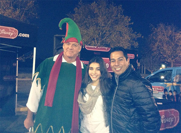 Madison and Ernie from Radio Disney pose with Garth the Elf at our Stuff-A-Bus event at Westfield Topanga mall in Canoga Park on Friday, Dec. 13, 2013. <span class=meta>(KABC Photo)</span>