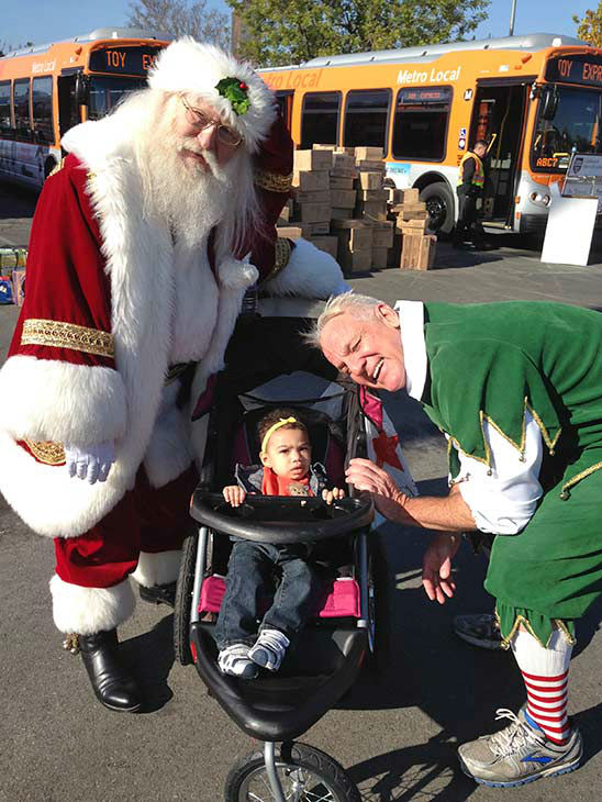 Garth the Elf poses with 1-year-old Bryanna from Woodland Hills at our Stuff-A-Bus event at Westfield Topanga mall in Canoga Park on Friday, Dec. 13, 2013. <span class=meta>(KABC Photo)</span>