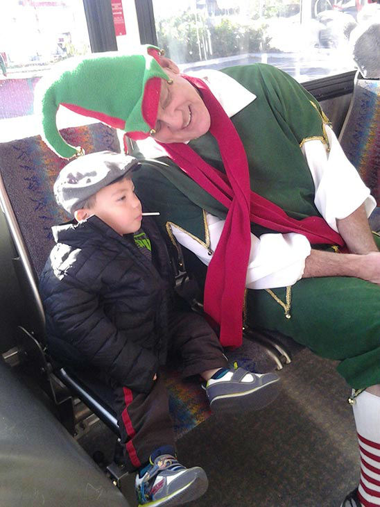 Garth the Elf poses with Cameron from Woodland Hills at our Stuff-A-Bus event at Westfield Topanga mall in Canoga Park on Friday, Dec. 13, 2013. <span class=meta>(KABC Photo)</span>