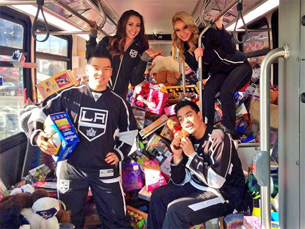 The Los Angeles Kings Ice Crew have some fun at our Stuff-A-Bus event at Westfield Topanga mall in Canoga Park on Friday, Dec. 13, 2013. <span class=meta>(KABC Photo)</span>