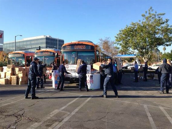 Los Angeles Fire Department cadets hard at work at our Stuff-A-Bus event at Westfield Topanga mall in Canoga Park on Friday, Dec. 13, 2013. <span class=meta>(KABC Photo)</span>