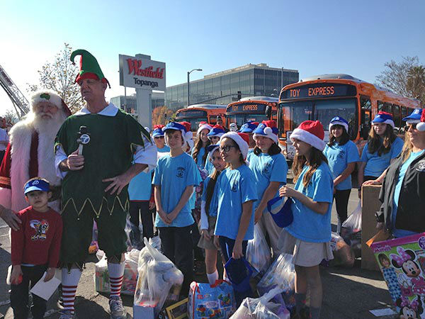 Students from Pinecrest Woodland Hills campus hang with Garth the Elf at our Stuff-A-Bus event at Westfield Topanga mall in Canoga Park on Friday, Dec. 13, 2013. <span class=meta>(KABC Photo)</span>