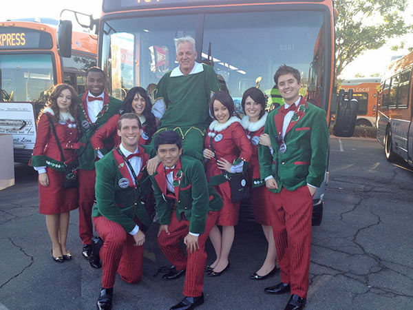 Garth the Elf poses with Westfield Topanga Disney Store castmembers at our Stuff-A-Bus event in Canoga Park on Friday, Dec. 13, 2013. <span class=meta>(KABC Photo)</span>