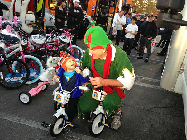 Garth the Elf hangs out with little Ethan at our Stuff-A-Bus event at Westfield Topanga mall in Canoga Park on Friday, Dec. 13, 2013. <span class=meta>(KABC Photo)</span>