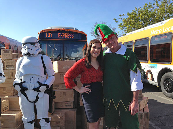 Garth the Elf poses with Victoria from JAKKS Pacific at our Stuff-A-Bus event at Westfield Topanga in Canoga Park on Friday, Dec. 13, 2013. <span class=meta>(KABC Photo)</span>