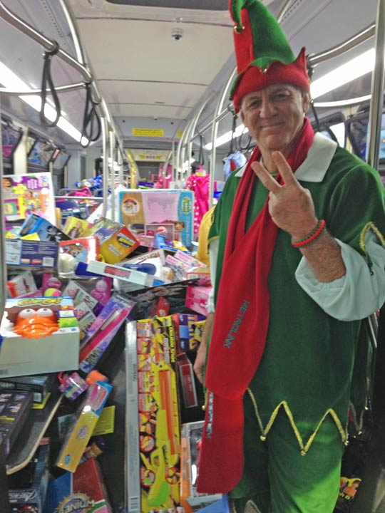 Garth the Elf stands inside stuffed bus No. 2 at the Honda Center in Anaheim on Friday, Dec. 20, 2013. <span class=meta>(KABC Photo)</span>