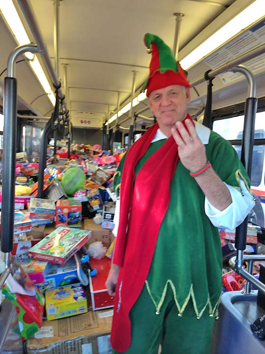Garth the Elf stands inside stuffed bus No. 3 at the Honda Center in Anaheim on Friday, Dec. 20, 2013. <span class=meta>(KABC Photo)</span>
