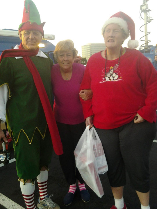 ABC7 viewers pose with Garth the Elf at the Stuff-a-Bus event at the Honda Center in Anaheim on Friday, Dec. 20. 2013. <span class=meta>(KABC Photo)</span>