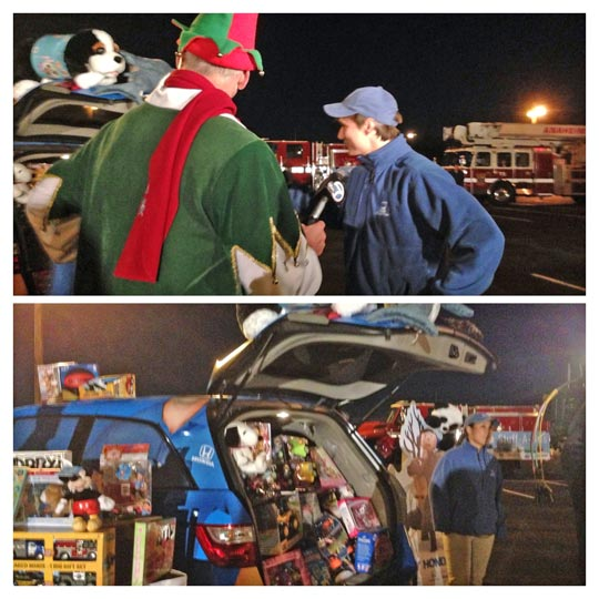 Members of the Helpful Honda team donate toys to the Stuff-a-Bus event in Anaheim on Friday, Dec. 20, 2013. <span class=meta>(KABC Photo)</span>