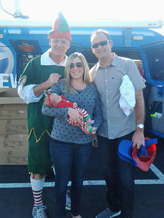 Garth the Elf poses with the Villwock family from Lake Forest at our Stuff-A-Bus event at the Honda Center in Anaheim on Friday, Dec. 20, 2013.  <span class=meta>(KABC Photo)</span>