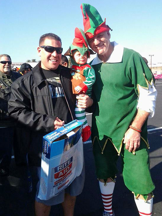Garth the Elf hangs with the Perez family from Westminster at our Stuff-A-Bus event at the Honda Center in Anaheim on Friday, Dec. 20, 2013. <span class=meta>(KABC Photo)</span>
