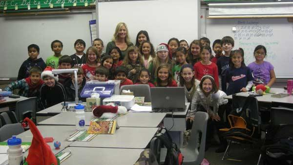 Mrs. Haitbrink's third grade class from Canyon Rim Elementary School helped Garth the Elf Stuff-A-Bus at the Honda Center in Anaheim on Friday, Dec. 16, 2011.