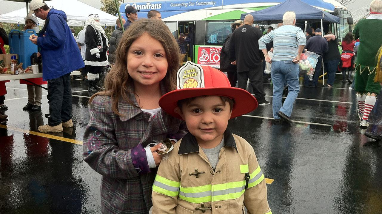 Two young viewers pose for a picture at ABC7s Stuff-A-Bus event at Mathis Brothers Furniture in Ontario on Friday, Nov. 30, 2012.