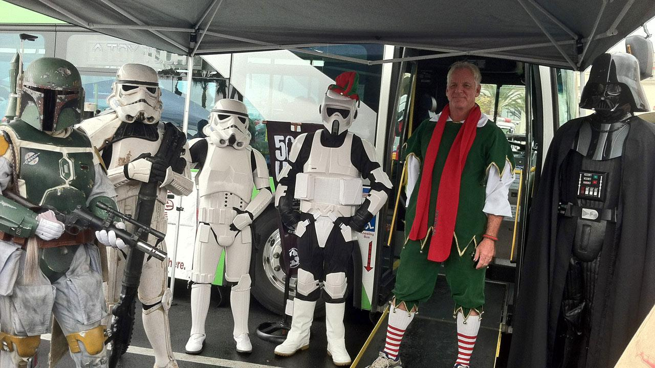 Garth the Elf with Stormtroopers at the Stuff-A-Bus toy drive at Mathis Brothers Furniture in Ontario on Friday, Nov. 30, 2012.