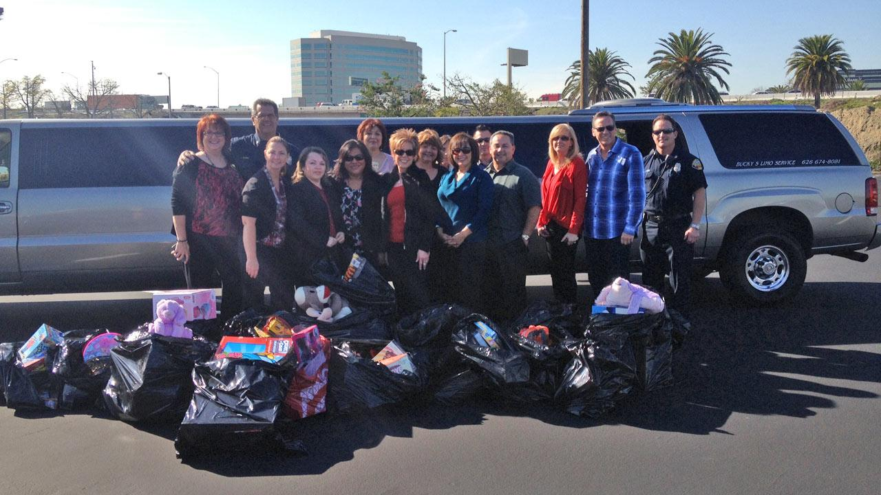Acclaim Marketing and Sales opted to collect toys instead of throwing themselves a Christmas party. They helped Garth the Elf Stuff-A-Bus at the Honda Center in Anaheim on Dec. 21, 2012.