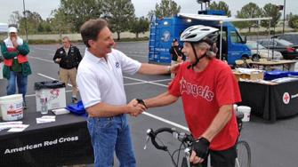 ABC7 Reporter Ric Romero greets a donor who came out to the Honda Center in Anaheim to help the Red Cross raise funds for the victims of the Oklahoma tornado on Wednesday, May 22, 2013.