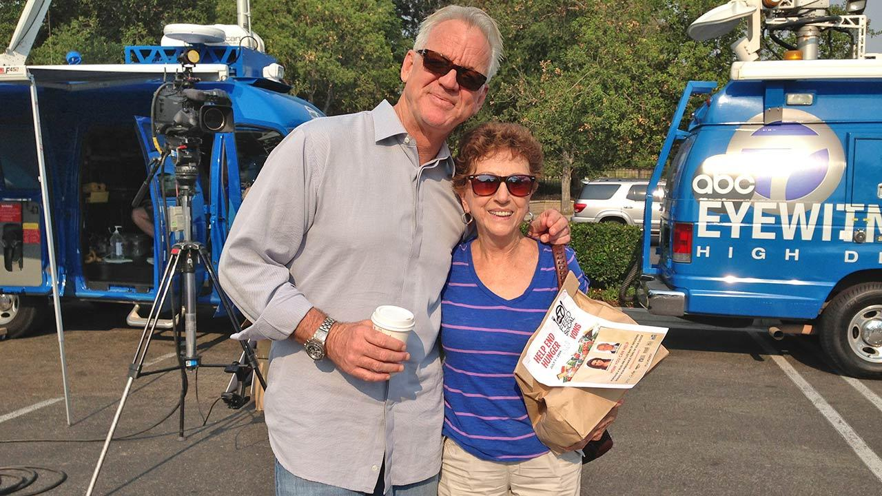 ABC7 Weathercaster Garth Kemp poses with Alba from Newbury Park at the Feed SoCal initiative in Thousand Oaks on Friday, July 19, 2013.