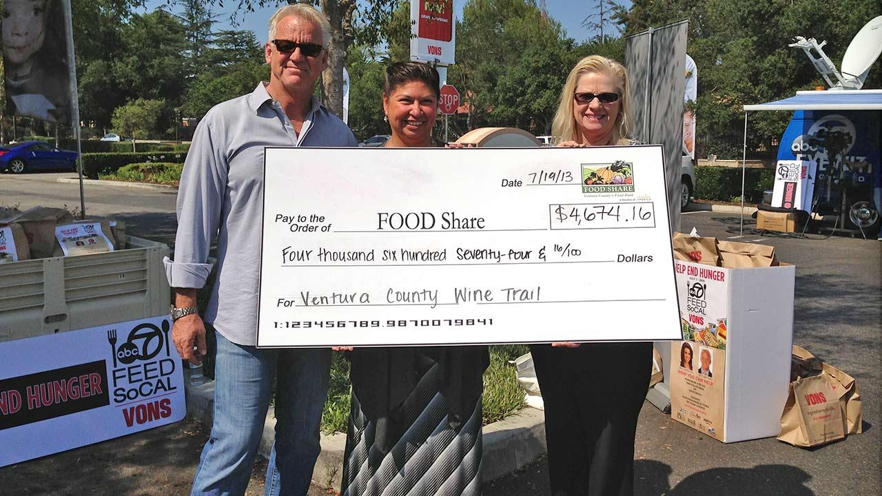 ABC7 Weathercaster Garth Kemp poses with representatives from Ventura County Wine Trail, who donated $4,674.16 at the Feed SoCal event in Thousand Oaks on Friday, July 19, 2013.