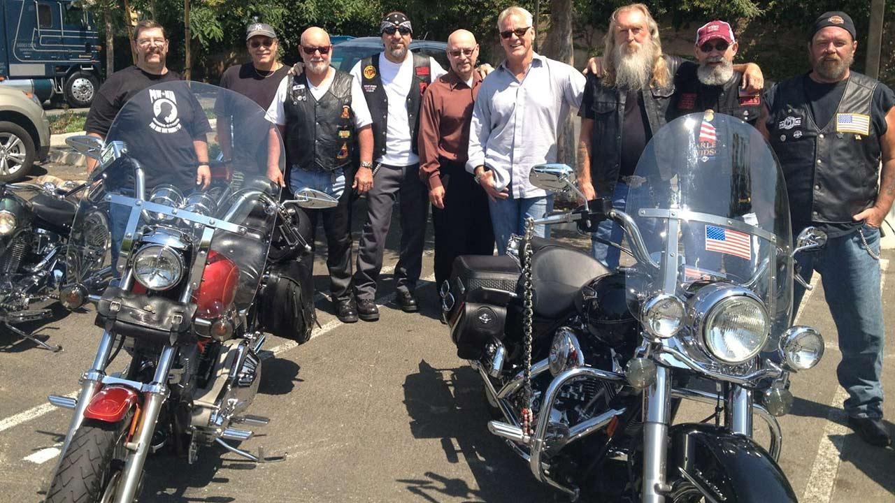 ABC7 Weathercaster Garth Kemp poses with members of the Rolling Thunder at the Feed SoCal event in Thousand Oaks on Friday, July 19, 2013.