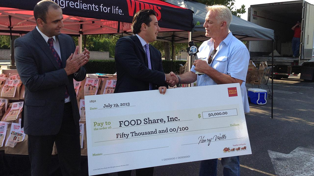 Wells Fargo donates $50,000 to FOOD Share during the Feed SoCal drive on Friday, July 19, 2013.