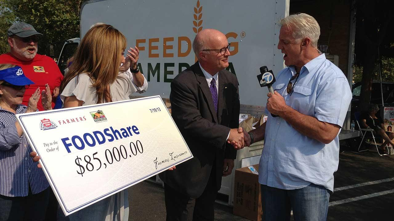 Farmers Insurance donates $85,000 to FOOD Share during the Feed SoCal drive on Friday, July 19, 2013.