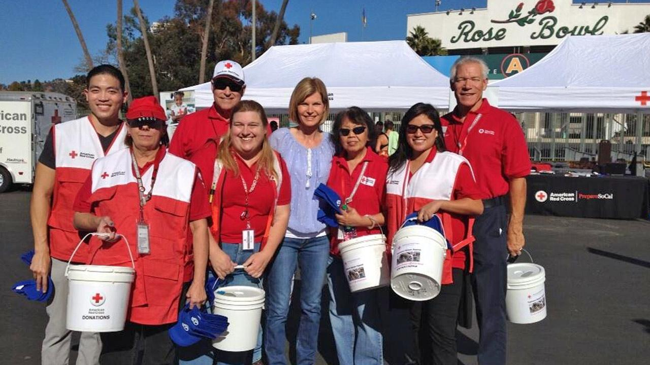 Eyewitness News anchor Michelle Tuzee poses with Red Cross volunteers at our ABC7 Relief Drive at the Rose Bowl for victims of Typhoon Haiyan on Wednesday, Nov. 13, 2013.