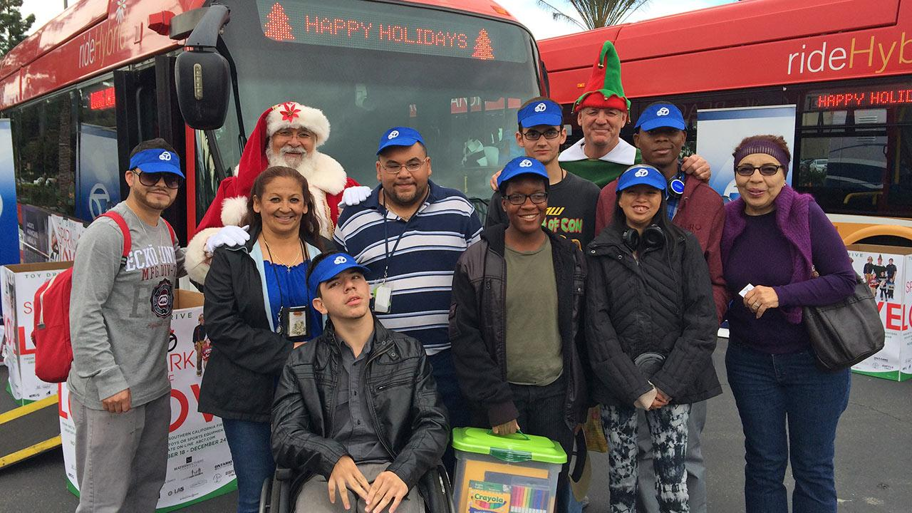 Members from the Norwalk-La Mirada adult transition program visit Garth the Elf at our first Stuff-A-Bus event of 2013 at Los Cerritos Center on Friday, Nov. 22, 2013.