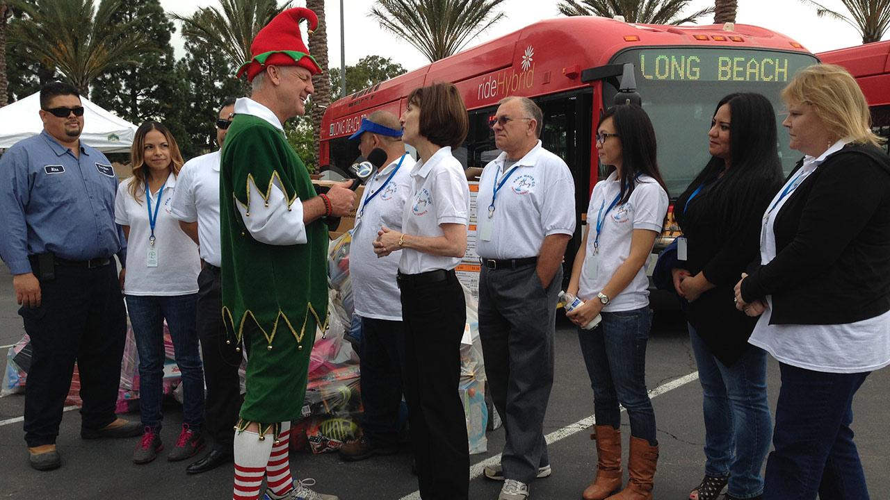 Employees from Park Water Co. drops off bags of toy donations at our first Stuff-A-Bus event of 2013 at Los Cerritos Center on Friday, Nov. 22, 2013.