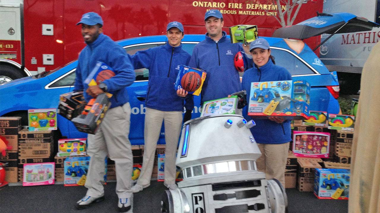 The Helpful Honda people donate toys to the Stuff-a-Bus event in Ontario Friday, Dec. 6, 2013.