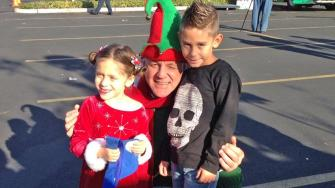 Joe and Ava brought toys to help Garth the Elf at the Stuff-A-Bus event in Ontario on Friday, Dec. 6, 2013.