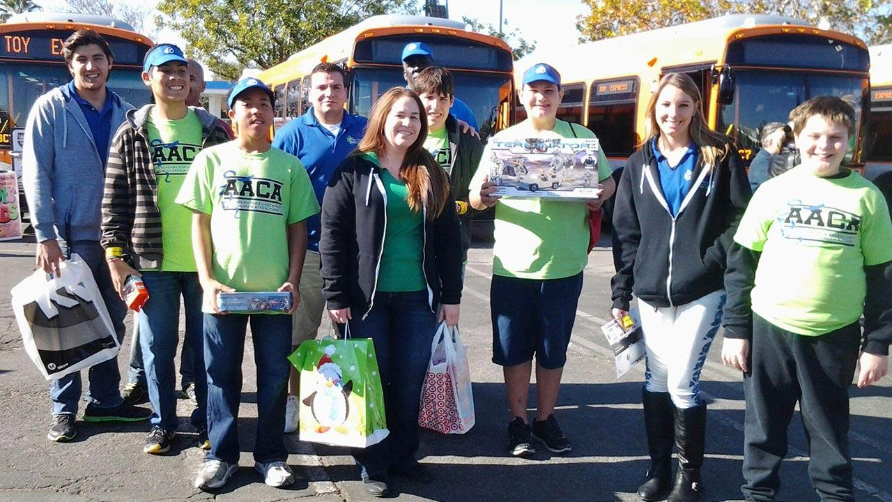 Students and faculty of the Academy for Advancement of Children with Autism stop by the Stuff-a-Bus event in Canoga Park on Friday, Dec. 13, 2013.