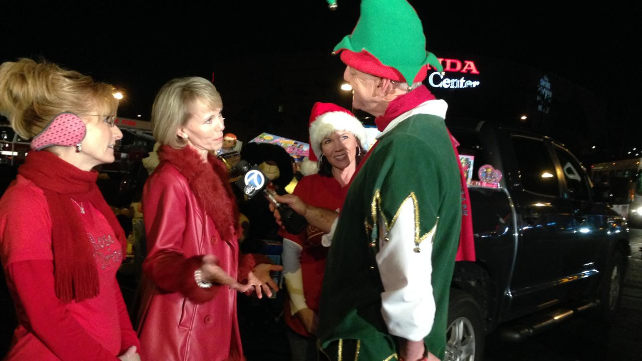 Representatives of Rose Drive Elementary in Yorba Linda speak to Garth the Elf after donating toys to the Stuff-a-Bus event at the Honda Center in Anaheim on Friday, Dec. 20. 2013.