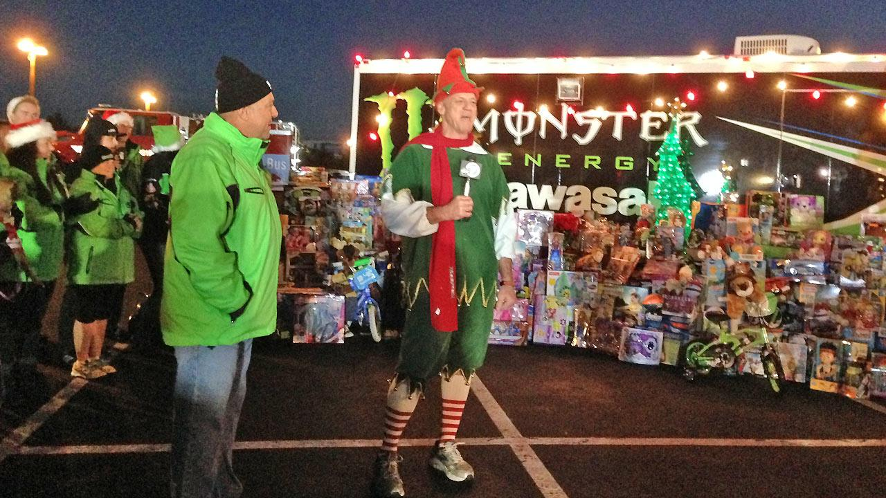 Employees from Kawasaki donate toys to the Stuff-a-Bus event in Anaheim on Friday, Dec. 20, 2013.