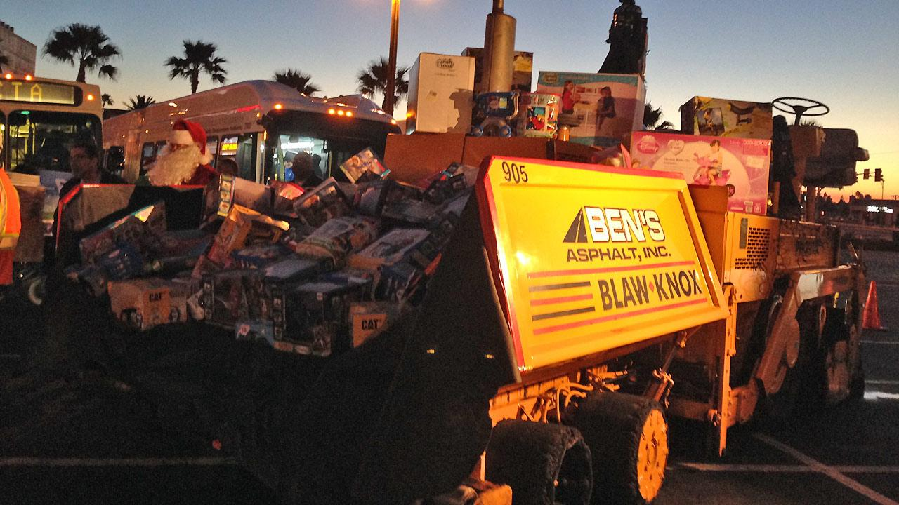 Bens Asphalt donates toys to the Stuff-a-Bus event at the Honda Center in Anaheim on Friday, Dec. 20. 2013.