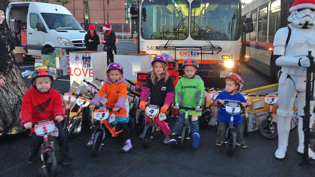 Children model bikes donated by Discovering Todays Motorcycles to the Stuff-a-Bus event in Anaheim on Friday, Dec. 20, 2013.