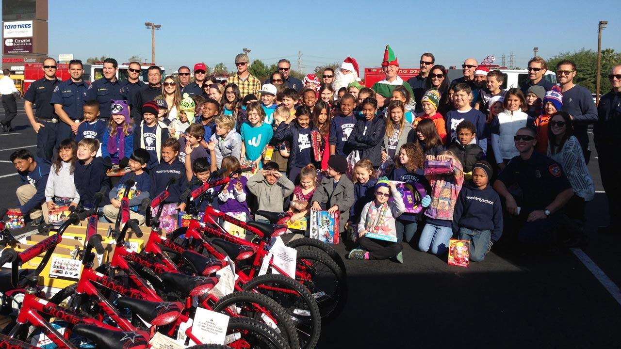 Students from Westerly Elementary in Long Beach stop by the Stuff-a-Bus event at the Honda Center in Anaheim on Friday, Dec. 20. 2013.
