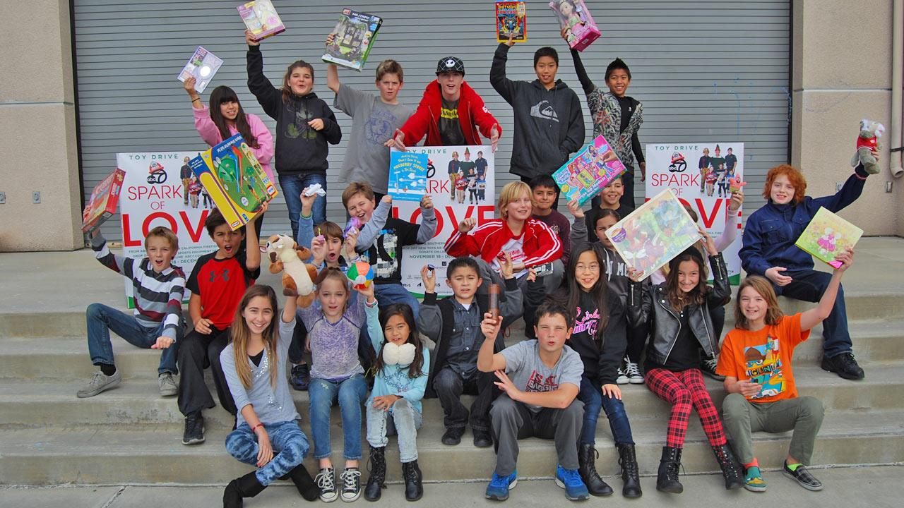 Students from Canyon Rim Elementary in Anaheim Hills donated toys ahead of the Stuff-a-Bus event at the Honda Center in Anaheim on Friday, Dec. 20. 2013.