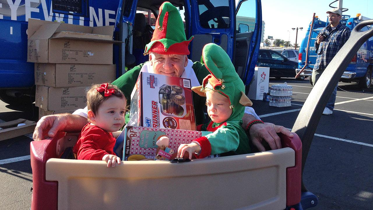 Garth the Elf hangs with some adorable future ABC7 fans at our Stuff-A-Bus event at the Honda Center in Anaheim on Friday, Dec. 20. 2013.