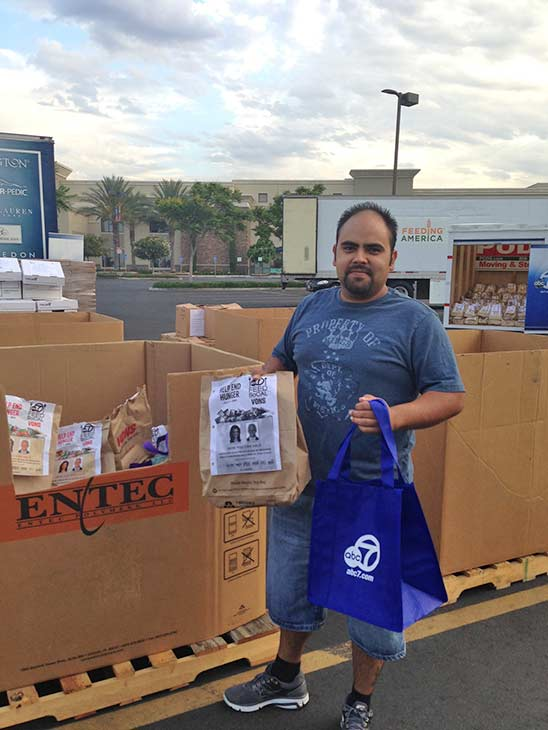 Chris from Fontana poses after making his donation at the Feed SoCal event in Ontario on Friday, July 26, 2013. <span class=meta>(KABC Photo)</span>