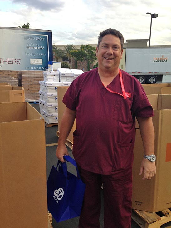 Chris from Victorville poses after making his donation at the Feed SoCal event in Ontario on Friday, July 26, 2013. <span class=meta>(KABC Photo)</span>