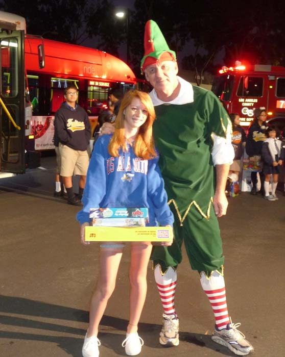 "<div class=""meta ""><span class=""caption-text "">Los Alamitos High School freshman Melissa poses with Garth the Elf at the 'Spark of Love Toy Drive' at Los Cerritos Center on Friday, Nov. 18, 2011. (KABC Photo)</span></div>"